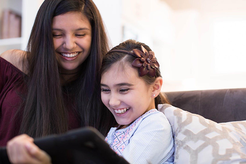 3x4-sisters-watching-tv.jpg